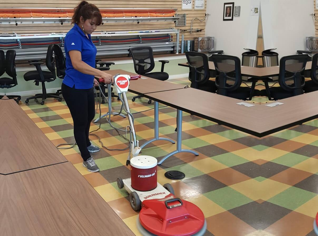 woman using power tool to clean the floor